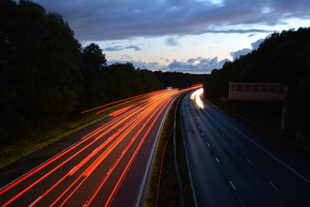 motorway early evening showing orange lines one side and small white line the other